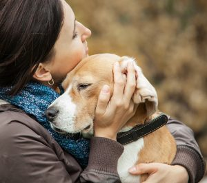 Woman With Her Dog Tender Hugs .