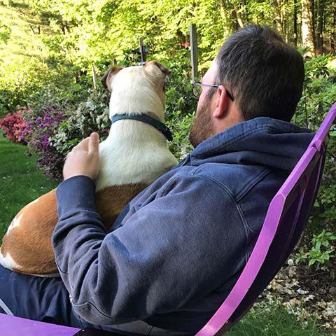 dog sitting on mans lap